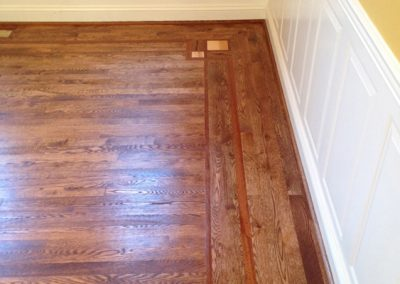 New custom installation unfinished Red Oak with Brazilian Cherry feature strip & maple corner squares